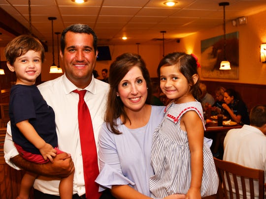 Tyler Sirois with his family, son Jack, wife Katy and daughter Emma Kate celebrating with  group of supporters at Kay's Real Pit Bar-B-Q in Cocoa. Sirois won more than 60% of the vote.