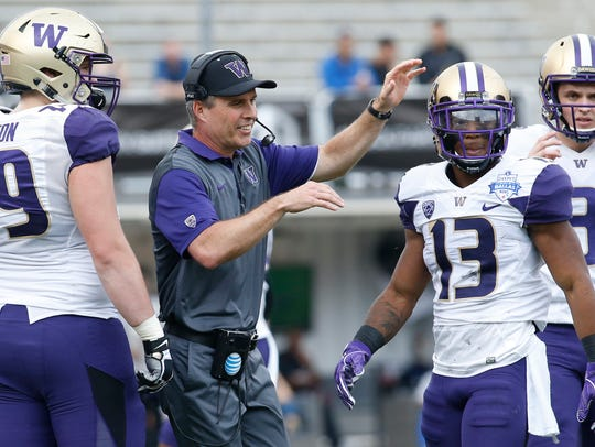 Washington Huskies head coach Chris Peterson reacts