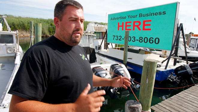 Charles Michaels speaks about his floating billboard docked in Point Pleasant Beach.