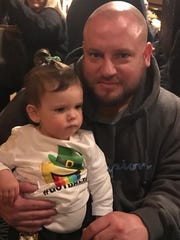 Danny Listmeier, 33, a beloved Clifton High School custodian, died last summer after a serious car accident. He's pictured with his cousin's daughter Addison Saba.