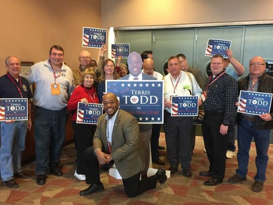 Local Republicans at the state convention over the weekend. Terris Todd, center, was elected as the Michigan GOP's ethnic vice chair.