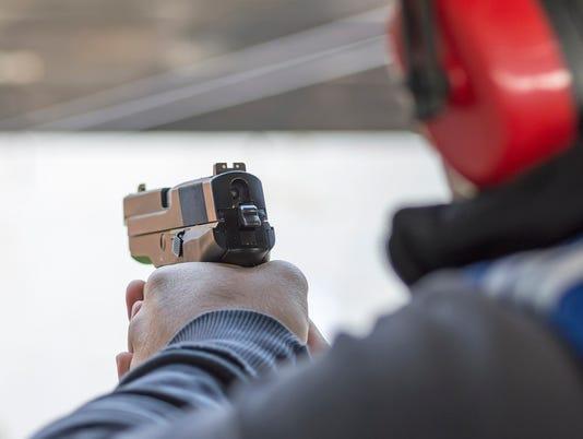 Shooting with Gun at Target in Shooting Range