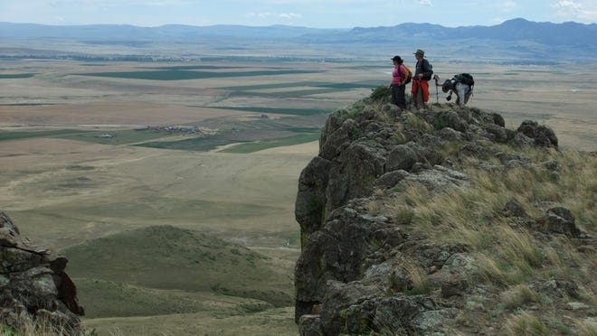 Hikers check out the view from Square Butte, which is on the list of 21 hikes planned this year during National Trails Day on June 3.