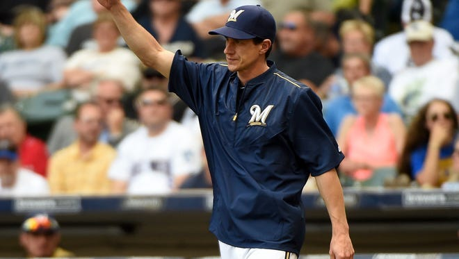 Milwaukee Brewers manager Craig Counsell makes a pitching change in the sixth inning against the Los Angeles Dodgers at Miller Park.