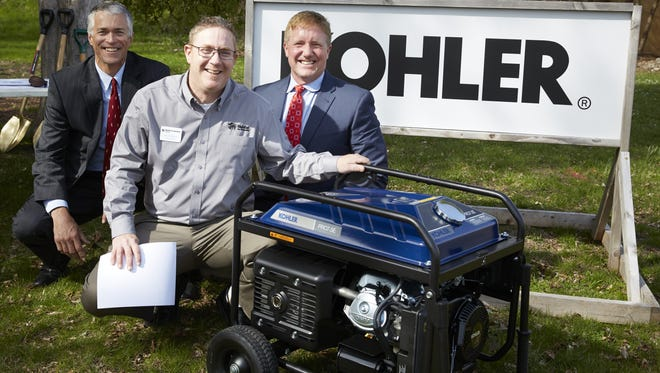 Kohler Power has partnered with Habitat for Humanity Lakeside to sponsor a homebuilding project on Erie Avenue in Sheboygan. Pictured with the portable generator donated to the nonprofit during the groundbreaking event are (from left) Larry Bryce, President – Kohler Power Systems; Jon Hoffman, Executive Director for Habitat for Humanity Lakeside; and Tom Cromwell, Group President – Kohler Power.