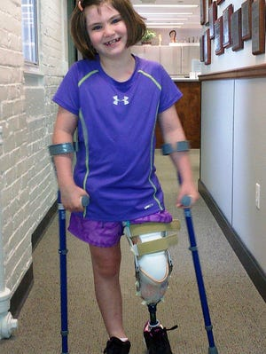 This photo released Thursday by the Richard family shows Jane Richard, 7, who lost part of her left leg in the Boston Marathon bombings.