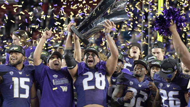 Washington celebrates its first conference title since 2000 after beating Colorado in the Pac-12 title game.