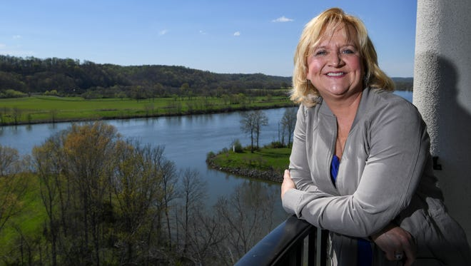 "Popular Christian comedian Chonda Pierce stands on her balcony at the her home in Ashland, Tenn., Tuesday, April 4, 2017. ""Some people want a place that overlooks the Eiffel tower. I like being perched over the Cumberland and the water plant,"" says Pierce."