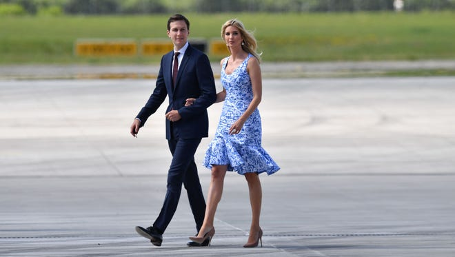 Kushner and wife Ivanka Trump make their way from  Air Force One to Marine One upon arrival at the airport in Hamburg on July 6, 2017.