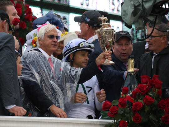 Justify trainer Bob Baffert celebrates in the winner's