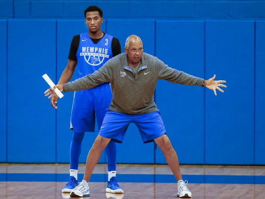 Memphis coach Tubby Smith (right) works with guard