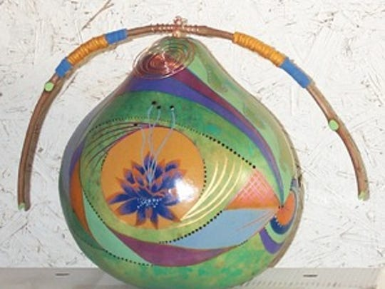 Gourd art by Beth McClure will be included in the annual art sale and studio tour taking place this weekend on Crouch Mesa.