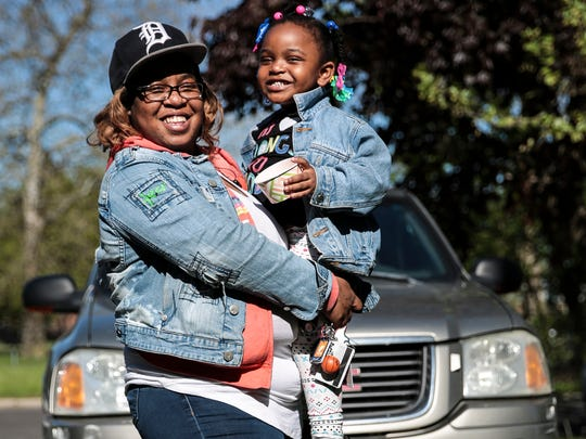 Adrian Fowler of Detroit poses for a photo with her daughter AdaLynn Washington, 3, in front of her car, Monday, May 15, 2017 in Detroit.