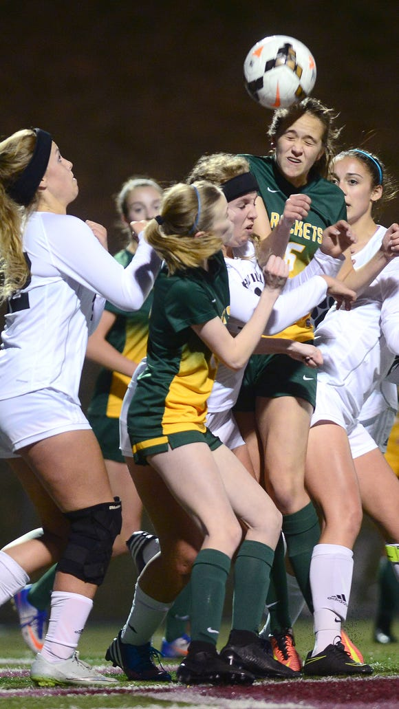 Reynolds' Annabelle Sparks wins a header during Monday's game at Asheville High.