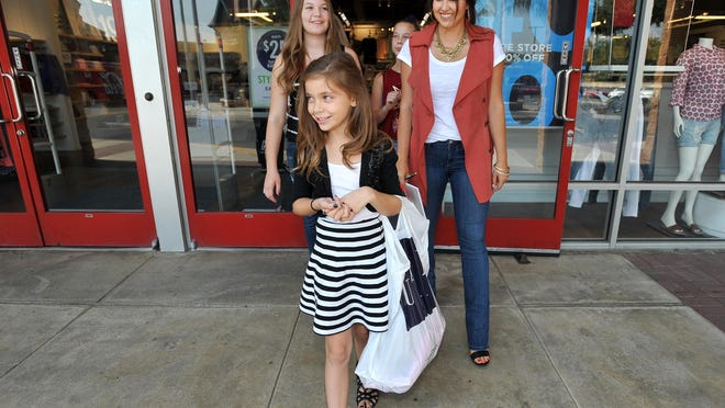 Times-Delta/Advance-Register Downtown Diva Danielle Martin shops with sisters Juliana Roche, 13, Chloe Roche, 11, and Kaitlin Roche, 8, at the Tulare Outlet Center on Tuesday.