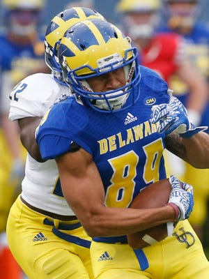 Delaware receiver Joey Carter tries to elude tackler Justin Watson during Delaware's Blue-White spring game at Delaware Stadium.