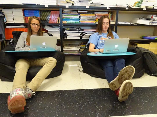 Galion freshmen Kerrigan Myers, left, and Amber Twigg said they're able to concentrate more on their school work while sitting in bean-bag chairs instead of traditional, hard seats.