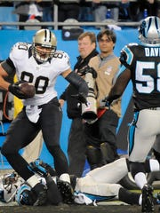 New Orleans Saints' Jimmy Graham (80) catches a touchdown pass against Carolina Panthers' Melvin White on Thursday.