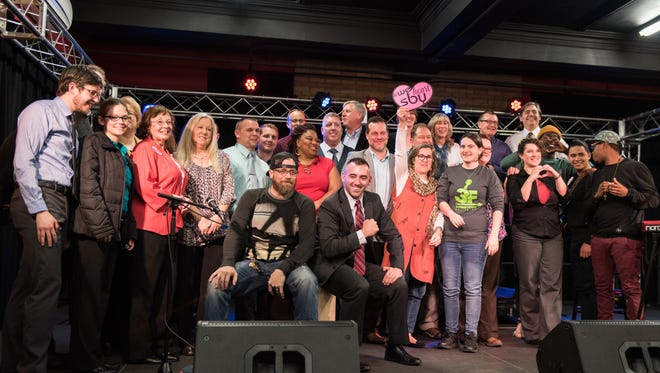 Presenters, nominees and award recipients pose for a photo during the We Heart SBY Awards at Headquarters Live on South Division Street on Thursday, Feb. 18, 2016.