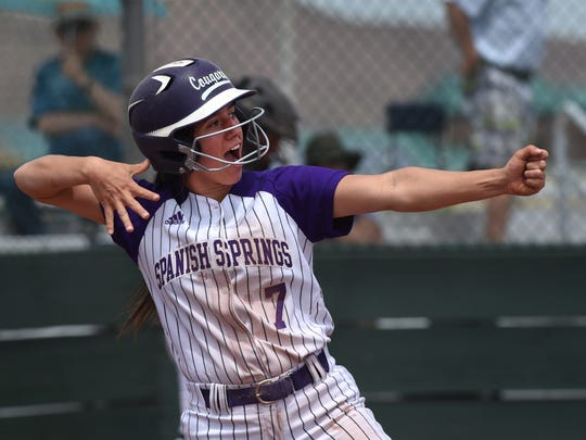 Spanish Springs' Courtney Huff celebrate scoring against the Reno Huskies in their playoff game at Bishop Manogue on May 10.