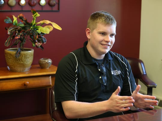 St. John Fisher College graduate Ryan Hohensee works with Beth Jeffries, assistant director of the college's Career Center, on interview skills.