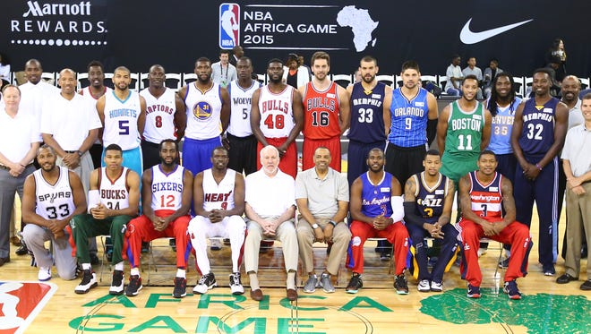 Players and coaches pose for NBA Africa Game 2015.