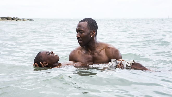 """""""Moonlight,"""" with Alex Hibbert, foreground, and Mahershala Ali, has received eight Oscar nominations including Best Picture, Best Director and Best Adapted Screenplay."""