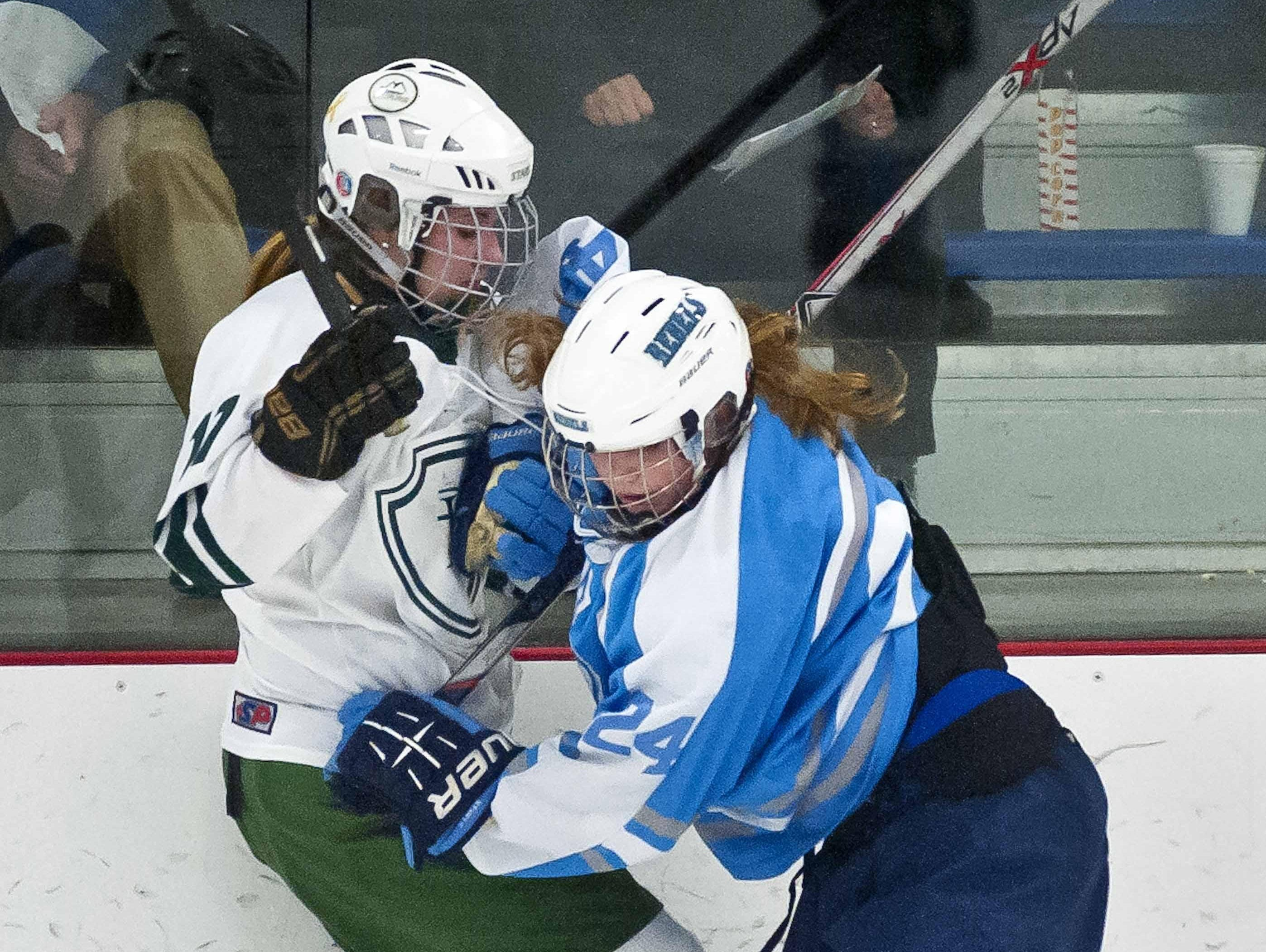 South Burlington's Rachel Pitcher (right) collides with Rice's Anna Connerty in a high school girls hockey game last season.