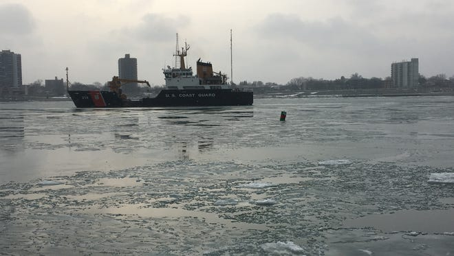 A U.S. Coast Guard boat is seen on the Detroit River west of downtown Detroit, in the area where a man was pulled from the water at about 10:50 a.m. Jan. 20, 2016.