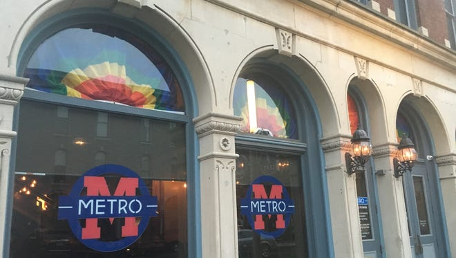 Bars along Massachusetts Avenue are showing their support for the LGBT community by hanging rainbow flags in their windows. Chet Van Wye, general manager of Metro Nightclub, said he has been concerned about the safety of his patrons and staff since the shootings early Sunday in Orlando, Fla.