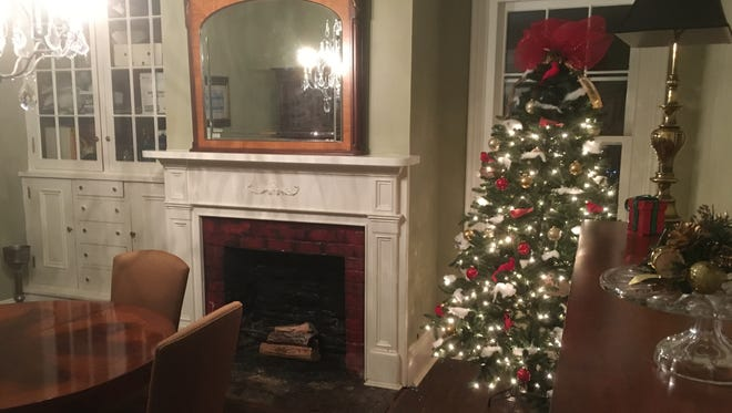 Christmas decorations adorn the restored dining room at the home of Alberto and Elaine Marranzano.