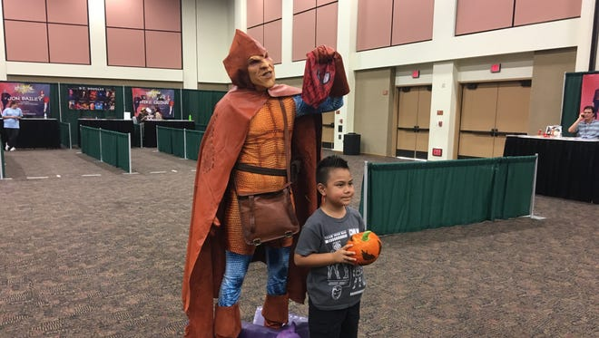 Cathedral City resident Edward Saenz, 6, poses with Orange resident Andre Rhoden, who dressed as Hobgoblin for Comic Con Palm Springs. Cosplayers came from across Southern California to attend the second event of the year at the Palm Springs Convention Center.