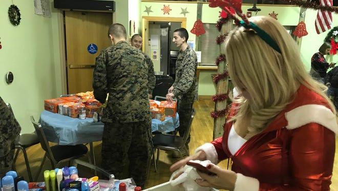 Scores of volunteers were on hand Monday evening at Clifton Senior Center to help with the packing of care packages for soldiers who are serving abroad this holiday season.