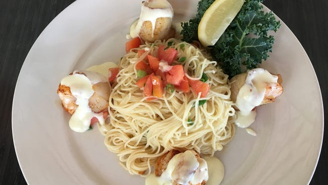 Shrimp are wrapped in thin slices of tilapia, baked and served with angel hair pasta and a rich sauce.