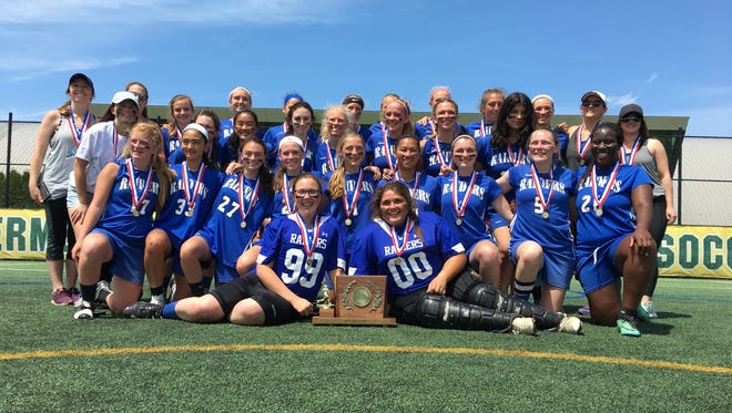 U-32 poses with the Division II trophy after winning the girls lacrosse title on Saturday. The Raiders edged defending champion Green Mountain Valley 9-8.