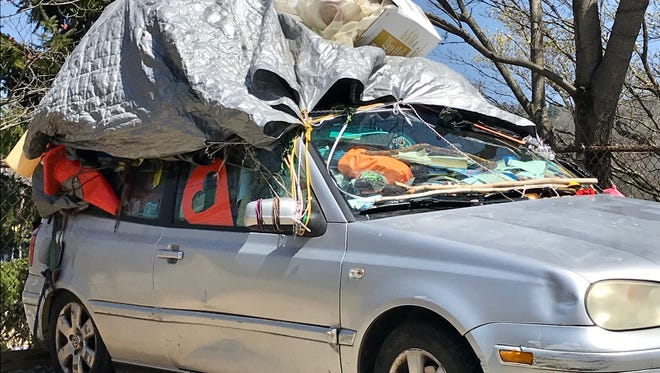 Camping in your vehicle in Asheville is not allowed on city streets, technically. But vehicles like this one, where someone is obviously living out of it, are not uncommon.