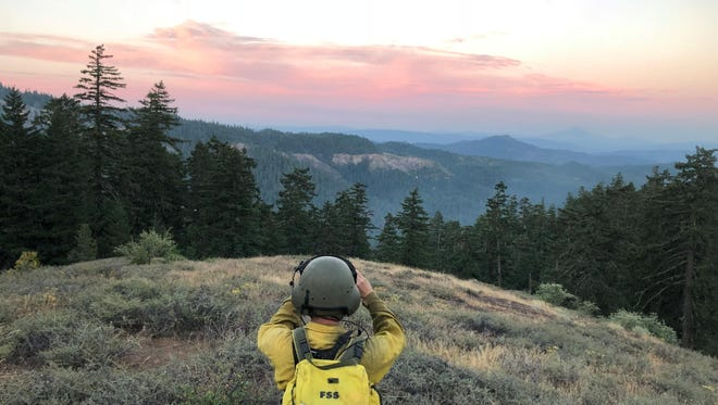 A crew member observes the Grave Fire in Southern Oregon.