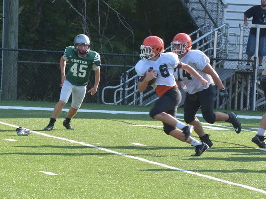 Powell quarterback Walker Trusley scores for the Panthers during a scrimmage at Carter.