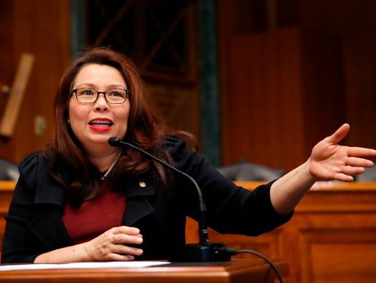 In this Feb. 14, 2018, file photo, Sen. Tammy Duckworth, D-Ill., speaks on Capitol Hill