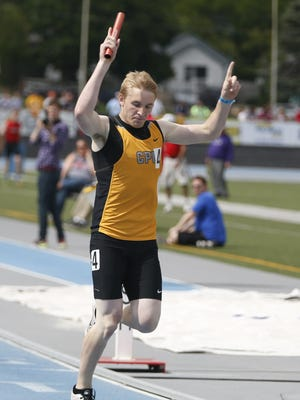 Center Point's Brandon Kinsey celebrates Saturday, May 23, 2015 as his team wins the boys 3-A 4x400 meter relay at the state track meet in Des Moines.