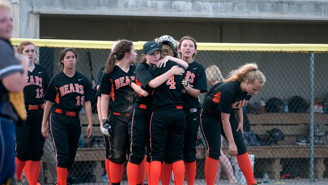 Gibsonburg's Katy Roberts is comforted by teammates after Thursday's Division IV regional semifinal matchup with Carey at Marathon Diamonds in Findlay.