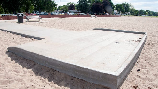 Holcomb Enterprises donated the materials and time to build a wheelchair pad at the city beach this week, at no cost to the city of Port Clinton.