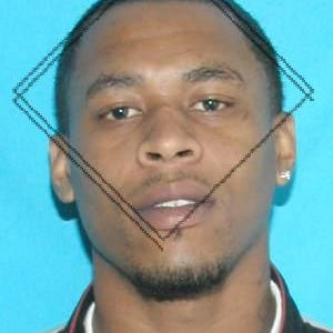 Darius Mitchell, marks on photos were present on copy sent from TBI