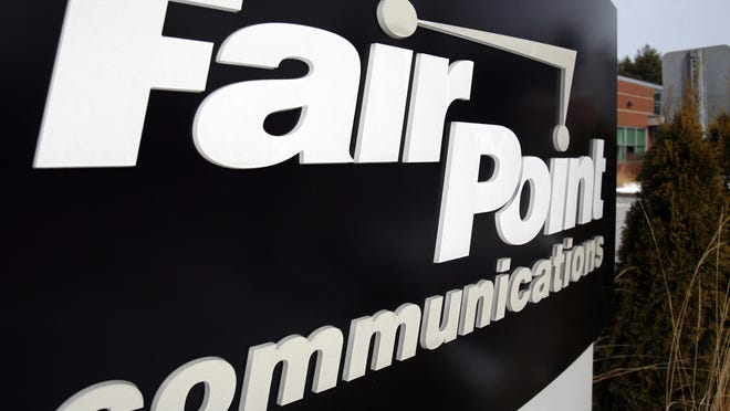 In this Feb. 8, 2010 file photo, a FairPoint Communications sign stands outside the company headquarters in South Portland, Maine. Maine regulators are the first to delve into the details of the $1.5 billion sale of FairPoint Communications to an Illinois-based broadband and business communications company.