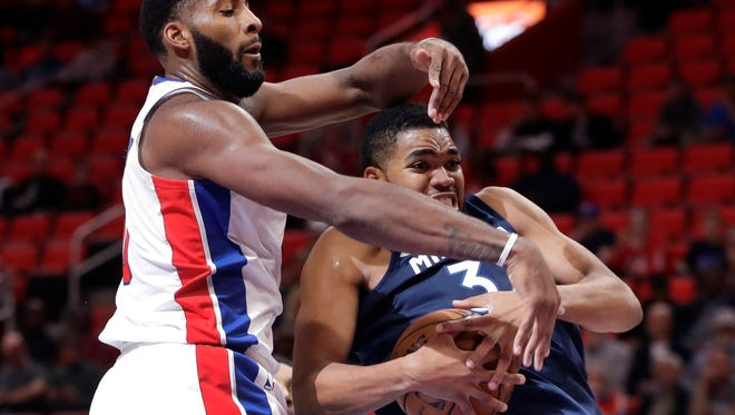 Timberwolves center Karl-Anthony Towns grabs a rebound in front of Pistons center Andre Drummond (0) during the first half on Wednesday, Oct. 25,2017, at Little Caesars Arena.