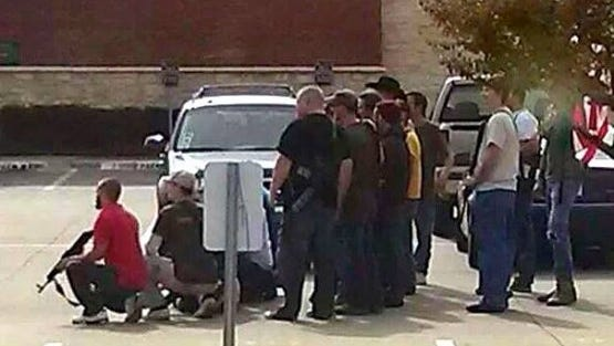 A member of the Texas chapter of Moms Demand Action for Gun Sense in America took this photo of an armed Open Carry gun advocates group that showed up outside a restaurant in Arlington, Texas, where the moms were meeting Saturday.