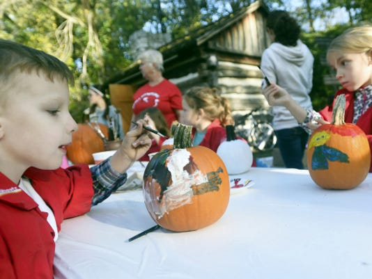 Painted pumpkins and painted faces were all over the Apple Festival at Tayamentasachta on Saturday. Ethan, 5, and Abigail Szumetz, 6, were two of the many children who spent some time at the pumpkin-painting station.