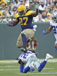 Green Bay Packers running back Eddie Lacy (27) leaps cornerback Morris Claiborne (24) against the Dallas Cowboys Sunday at Lambeau Field. (Photo: Jim Matthews/USA TODAY NETWORK-Wisconsin/@jmatthe79)