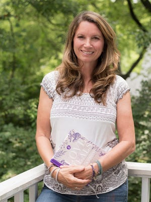 Rev. Becca Stevens, founder of Nashville women's healing center Thistle Farms, poses with her 2017 book Love Heals