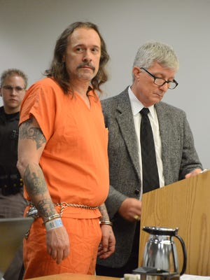 Jackie McConnell with his attorney Mike Lind at his sentencing in September 2014.